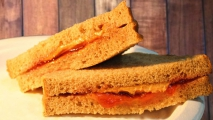 <h5>Peanut Butter with Strawberry Preserves on Wheat</h5>